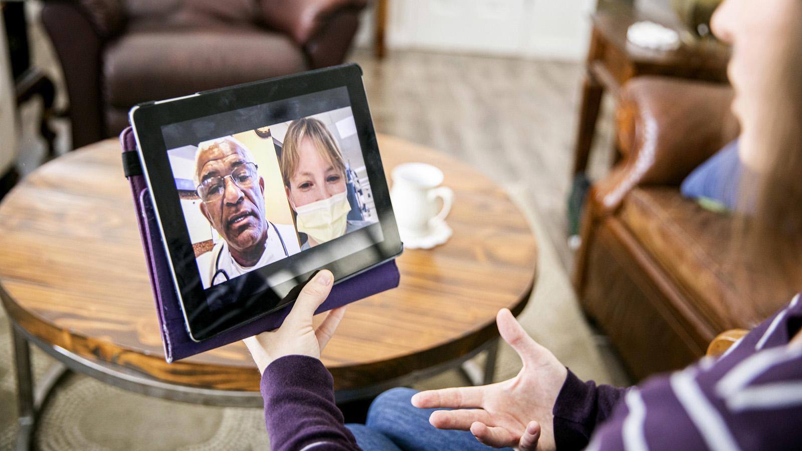 A young woman receiving healthcare through video call